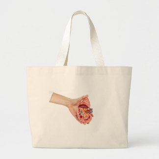 Female hand holds model of human kidney large tote bag
