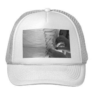 Female hand lacing up wedding dress back mesh hats