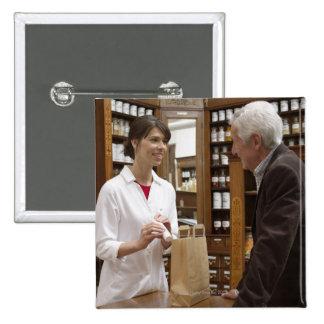 Female pharmacist advising customers 15 cm square badge