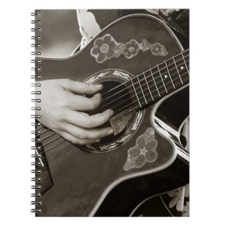 Female with acoustic  Guitar hand and hip view Notebook
