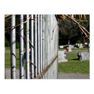 Fence at a cemetery post card