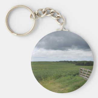 fence gate in front of field with mowed horseshoe key ring
