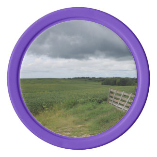 fence gate in front of field with mowed horseshoe poker chips
