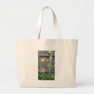 Fence with Lillies Tote Bag