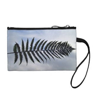 Fern leaf isolated against the sky coin purse