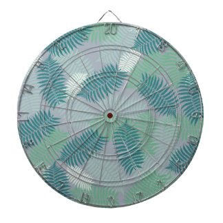 fern leaves pattern on light grey dartboard with darts
