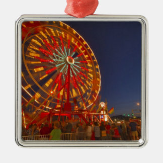 Ferris wheel at dusk at the Northwest Montana Silver-Colored Square Decoration