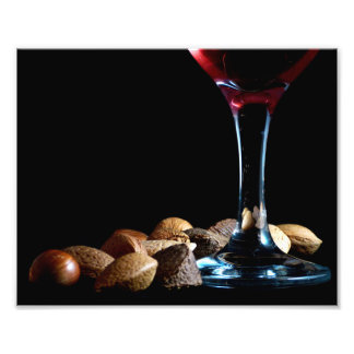 Festive photograph of a wine glass and nuts