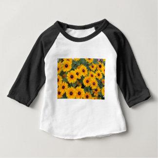 Field of yellow daisies baby T-Shirt