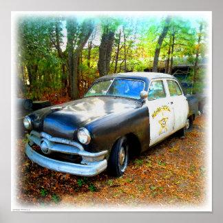 Fifties Highway Patrol Car in Junk Yard Weeds Poster