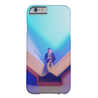 Figurine sitting on open book barely there iPhone 6 case