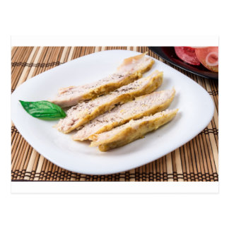 Fillets cut into pieces of baked chicken postcard