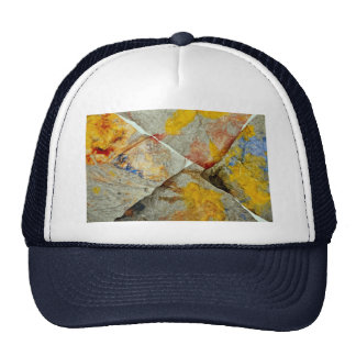 Finger paint on corners of four paper towels hat
