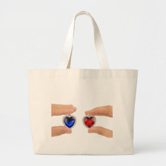 Fingers holding blue and red jewelry hearts jumbo tote bag