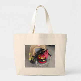fire fighter helmit on chair jumbo tote bag