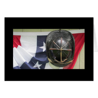 Fire helmet and flag greeting card