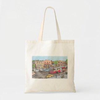 Fire truck rushes down a city street tote bag