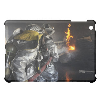 Firefighters extinguish a fire in a training ro iPad mini cases