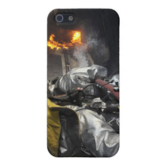 Firefighters extinguish a fire in a training ro iPhone 5/5S cover