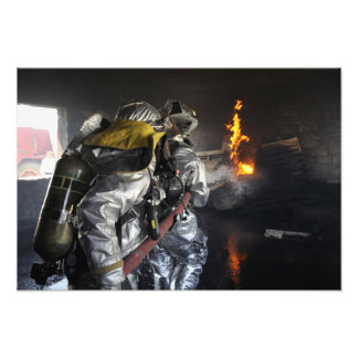 Firefighters extinguish a fire in a training ro photographic print