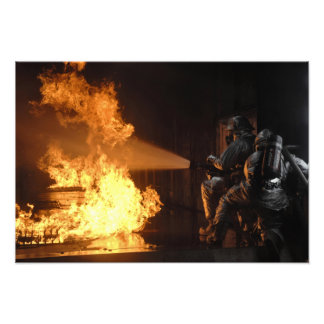 Firefighters extinguish a simulated battery fir photographic print