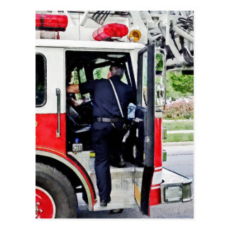 Fireman Climbing into Fire Truck Postcard