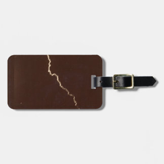 First ever photograph of lightning bolt - 1886 luggage tag