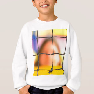 Fischer net with woman in the background sweatshirt