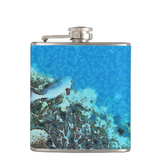 Fish moving over the reef hip flask