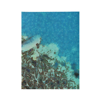 Fish moving over the reef wood poster