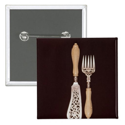 Fish-servers with carved ivory handles pin
