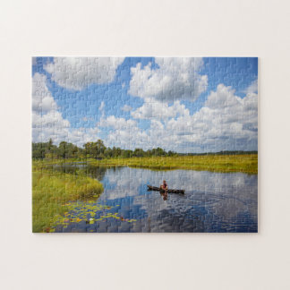 Fisherman on a lake in Guyana. Jigsaw Puzzle