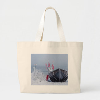Fishing boat on shore of the Baltic Sea in winter Tote Bags