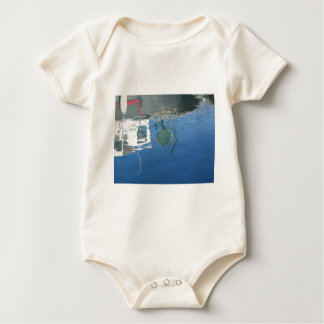 Fishing boat reflects in the water baby bodysuit