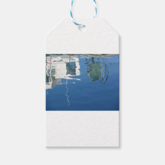 Fishing boat reflects in the water gift tags