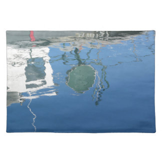 Fishing boat reflects in the water placemat