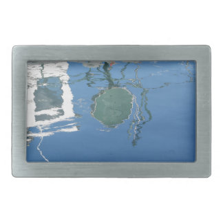 Fishing boat reflects in the water rectangular belt buckles