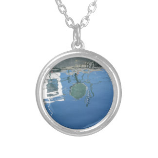 Fishing boat reflects in the water silver plated necklace