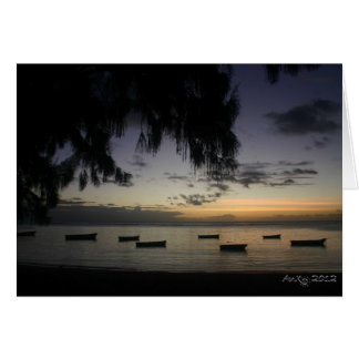 Fishing boats at sunset card