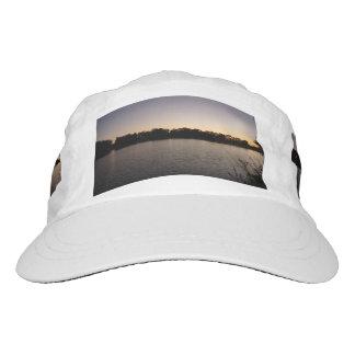 Fishing poles silhouette against the sun set hat