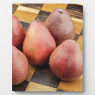 Five Red Pears on a Wooden Chessboard Plaque