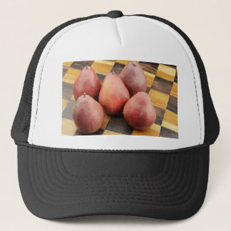 Five Red Pears on a Wooden Chessboard Trucker Hat