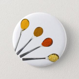 Five seasoning spices on metal spoons 6 cm round badge