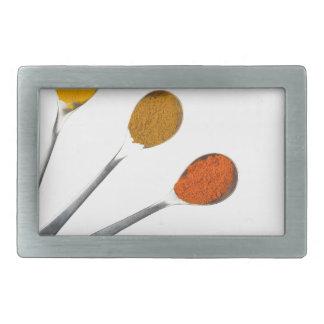 Five seasoning spices on metal spoons belt buckles