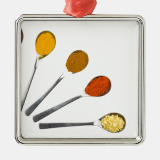 Five seasoning spices on metal spoons Silver-Colored square decoration