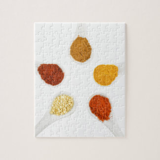 Five seasoning spices on porcelain spoons puzzles