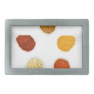 Five seasoning spices on porcelain spoons rectangular belt buckle