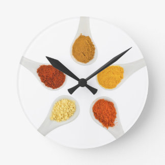 Five seasoning spices on porcelain spoons wall clock