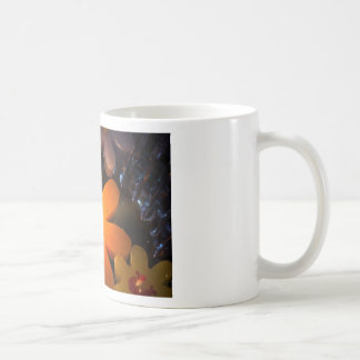 Flame from an orange floating candle coffee mugs