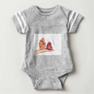 Flat hand showing model human kidney baby bodysuit